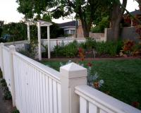 white picket fence with arbor in front garden of Melbourne home