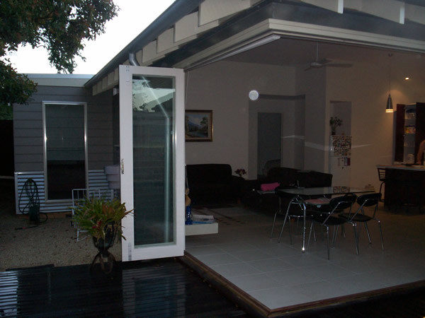 white rimmed external bi fold onto timber decking in melbourne