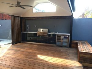 outdoor living room with bbq with timber decking and seating with roof in sandringham suburb of melbourne