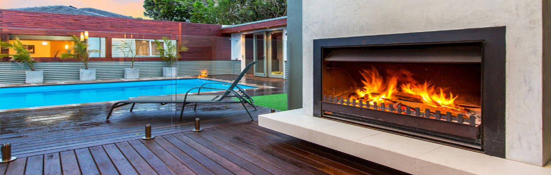 timber deck with outdoor fireplace and swimming pool