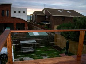upstairs timber decking with stainless steel and timber railing in bayside suburb of melbourne