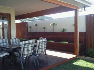 merbau timber fence with matching merbau timber decking and bench seat in outdoor living room of melbourne home