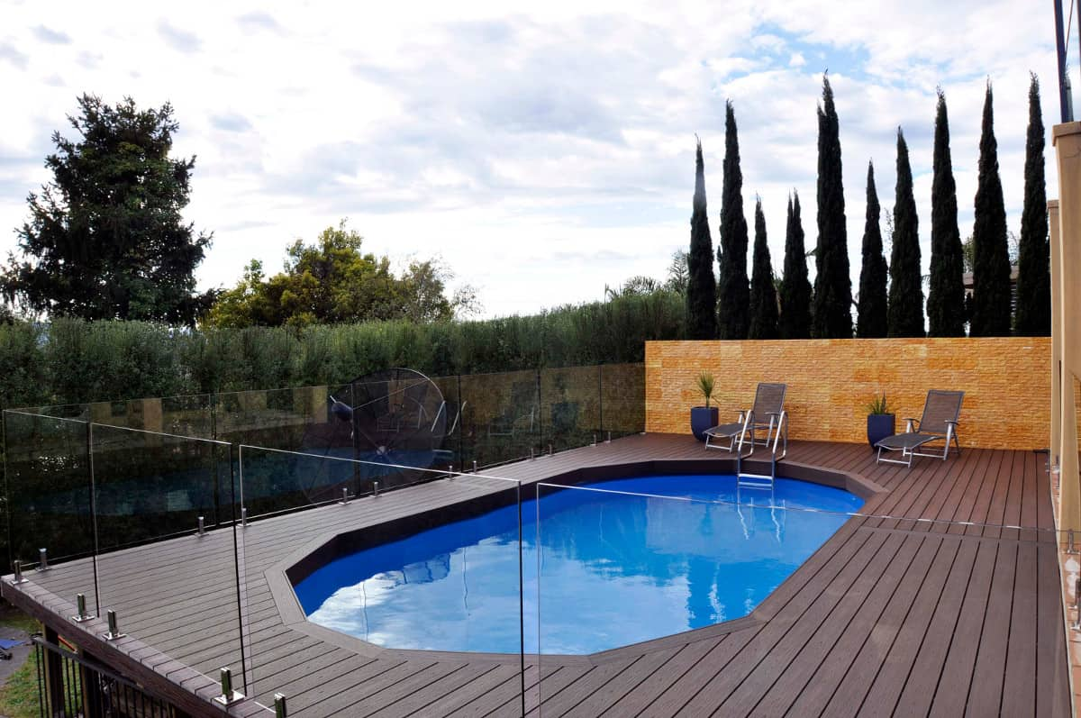 frameless glass pool fence with composite decking and landscaping in eastern suburbs of melbourne