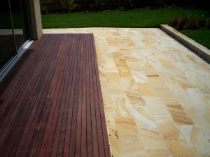 merbau timber decking with decorate stones in outdoor entertaining area in melbourne