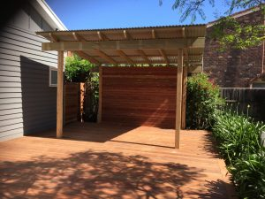 outdoor living area with timber decking and timber pergola in south eastern suburb of melbourne