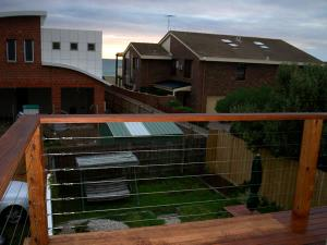 Balcony-with-merbau-stainless-steel-wire-railing