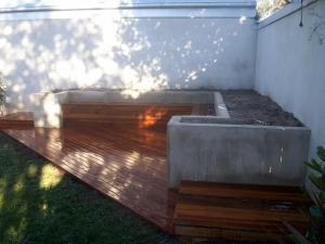 Courtyard with decking and corner seat and storage