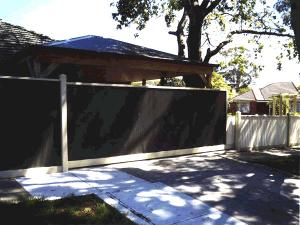 Pitched carport roof with colorbond fence