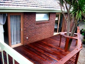 Timber deck and railing built around tree