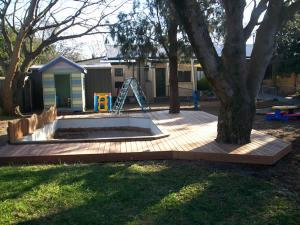 Timber decking around kindergarten sandpit