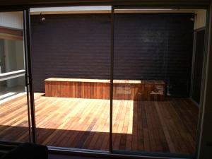 Timber decking in merbau with storage seat