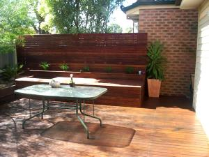 Timber merbau decking with privacy screen and seat