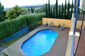 Composite decking around swimming pool