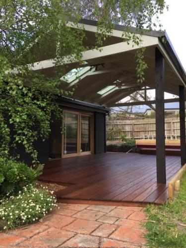 Covered timber deck with skylights in roof