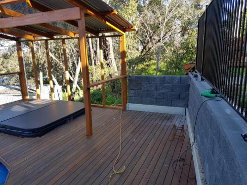 Tmber deck for spa with pergola