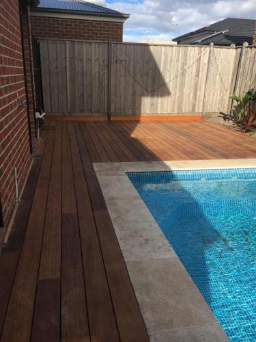 Timber decking surrounding swimming pool
